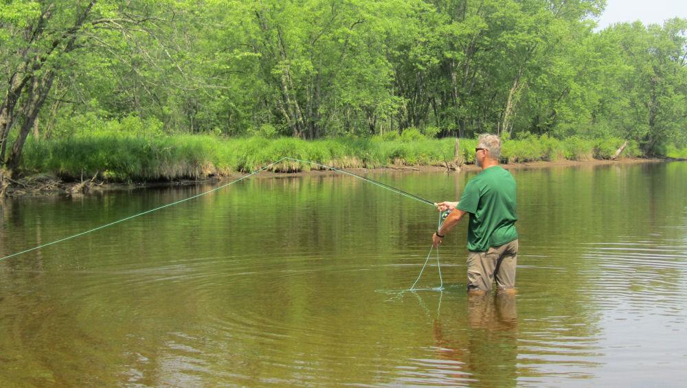 Tom casting in river